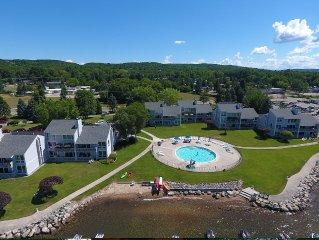 Lake Charlevoix waterfront, boat slip, lake side pool, free wireless,