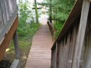 Steps from deck to dock with railing
