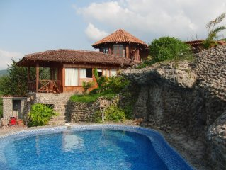 Gorgeous Spanish Style home with Pool and adjoining cottage!!