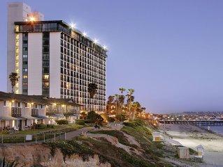 Seaside Condominium Suites Overlooking Sandy Beac