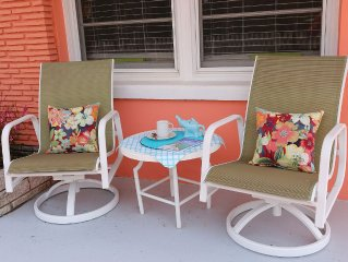 Lazy Days on the Front Porch at Coral Cottage, Only Steps from South Beach Park