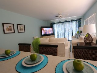 The Family Room at Coral Cottage - as seen from the Kitchen Bar - 70' HD TV!