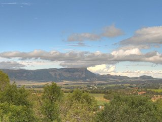 Mountain and Mesa Verde views ensconced in an elegant designer home on 6 acres