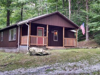 Rustic cabin w/ modern amenities on 600-ac. nature preserve with 10-mi of trails