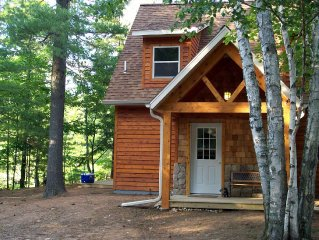 This northwoods feel cabin is within 75 ft from the sandy edge of sparkling