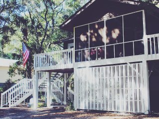 Book  this sweet cottage at the beach.