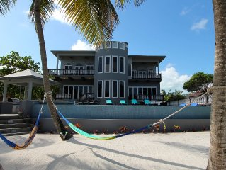 SUMMER & FALL SPECIAL! An unBELIZEable home...Barefoot beachfront luxury!