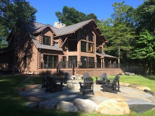 Custom Log Home across from All Sports Lakes