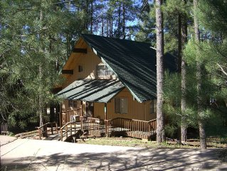 Welcoming, lake view cabin. Tall pines, game room, large deck. 5-Star clean.