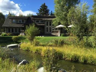 Premier westbank location on the creek-sleeps 9+ with guest house option.