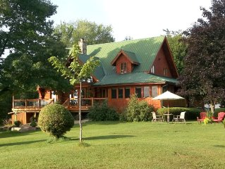 Scribed Log Home On Big Rideau Lake Near Portland with separate lakeside cabin