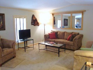 Cozy living room with comfy couches, flat screen satellite TV. Wifi too!
