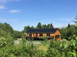 Private home with river and onsite trails, 1 mile from ski area, 32 acres, sauna