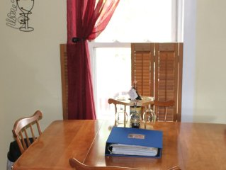A guestbook with area information & a complimentary bottle of wine await guests.