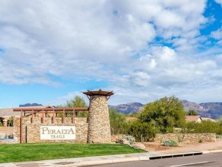 Gorgeous mountain views and desert washes define this serene gated community