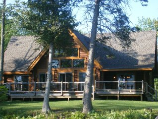 Lakefront Log Home Near Mackinaw.  Spring and Summer is around the corner!