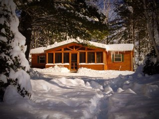 Four season cabin on lake  with  a sandy beach family-friendly and pet-friendly.