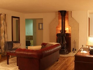 Warm Gas Fire Place And Glossy Oak Floors Make Gathering A Real Treat