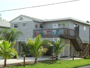 2 bed/3 bath within a few steps of the beach and walking distance of the town