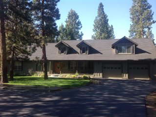 Custom spacious home on one acre of pines will accomodate large group