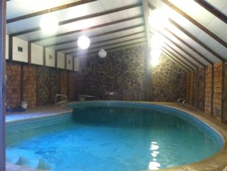 4000 Sq ft home w/ private heated indoor pool with turbo twist slide!