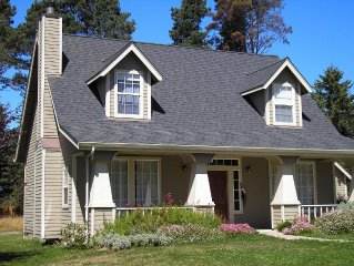 Charming craftsman home on 1.1 acres close to town and beautiful beaches