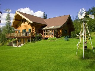 A true Alaskan experience awaits you! This natural log home wraps you in warmth.