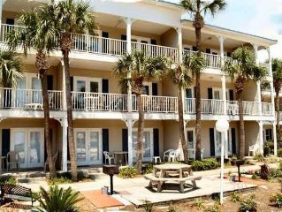 Cute 2/2 condo with BEACH SERVICE!  Two King beds plus hall bunks.