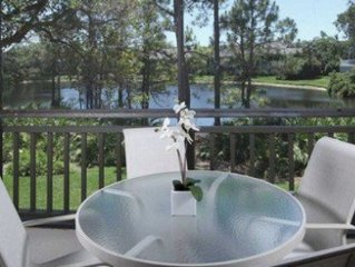 Large, corner 2nd floor unit! Gorgeous view of lake from wrap-around lanai!