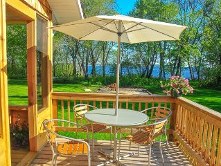 Beautiful Cedar House Lakefrontage Facing Elk Island in the Non Restricted Area