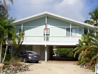 Welcome to Our Peaceful Old Florida Style Canal Front Cottage!