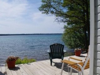 BEAUTIFUL COTTAGE ON TORCH LAKE WITH PRIVATE FRONTAGE