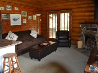 Dream by the fireplace in our lovely log home!