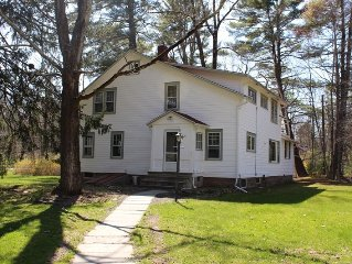 Charming and spacious Woodstock farmhouse walking distance to town.