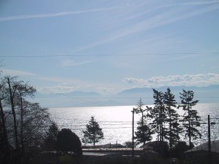 Bright South Facing Home Looking Across Juan De Fuca Strait To The Olympics Mntn