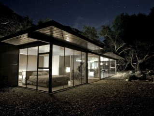 Glass home, with river, night sky & privacy What more can you ask for?