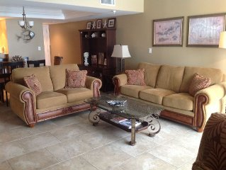 GROUND FLOOR UNIT  3BR/3BA  2 master bedrooms with views of the pool and  beach