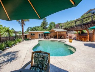 Charming Pool House with private pool, hot tub, and patio area.