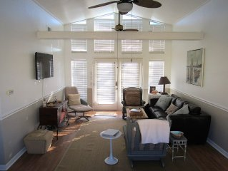 Living room is comfortable  with  ,cable tv, games and vaulted ceilings. RELAX!