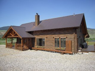 Stunning log home 300 ft. from Madison River. Perfect for large groups.