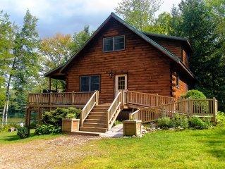 Maine lakeside log cabin, 3 bed, 2bath, cap. 8, hot tub, boats, dock, swim raft