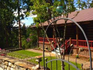 Delightful Log Cabin Home on Seven Acres with Charming Decor & Spacious Living