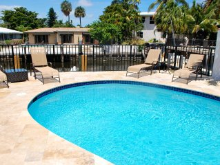 Tiki Hut 4 bedroom 3Bath Waterfront vacation rental pool home steps to the beach