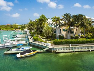 Spectacular Marina & Sunset Views, Suite & Private Terrace Right on Turtle Cove