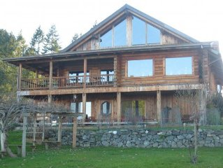 Beautiful log home overlooking the magnifcent Puget Sound.