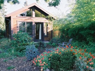 Quiet getaway in a large organic garden, and close to everything.