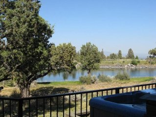 Gaze across the lake from the spacious back deck and hot tub! **Dog-friendly**
