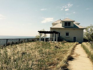 Panoramic Lake Michigan home and Private Beach.