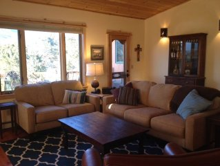 Custom Southwestern Home: Mountain Views, Hot Tub, Kiva Fireplace.