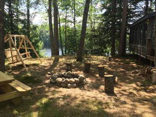 Side yard with swing, picnic table, and fire pit